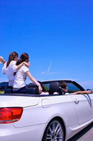 Four people sitting in the car and enjoying leisure activity