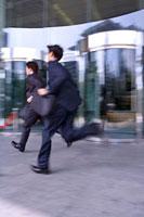Two businessmen running fast