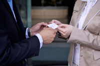 Young man and woman delivering name card