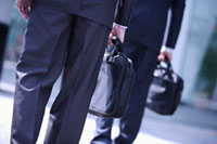 Two businessmen well-dressed standing and holding briefcase 11010043822| 写真素材・ストックフォト・画像・イラスト素材|アマナイメージズ