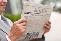 Senior businessman reading newspaper