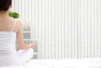 Woman making lotus position