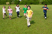 Group of children running on lawn