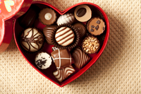 Close-up of chocolates in a heart-shape box
