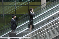 Business people on escalator