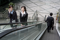 Business people on escalator, elevated view