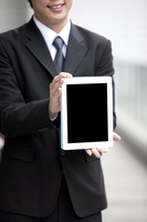 Businessman holding palmtop with smile