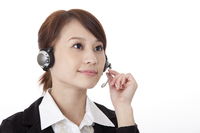 Businesswoman wearing headphone and looking up with smile
