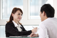 Businessman and businesswoman sitting and talking