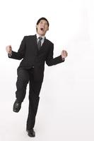 Businessman laughing with fists up 11010046300| 写真素材・ストックフォト・画像・イラスト素材|アマナイメージズ