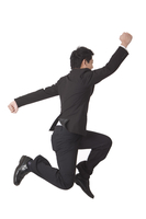 Businessman jumping with arms outstretched and feet up