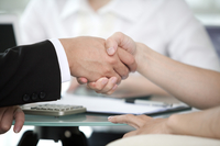 Business person shaking hands together