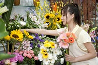 Female florist picking flowers to add into a bunch