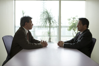 Business men sitting and talking