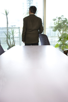Business man standing and looking away