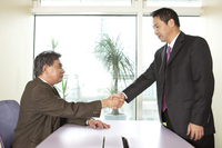 Business man shaking hands together