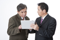 Business men holding and looking at the note pad together