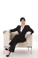 Businesswoman sitting on sofa and smiling at the camera