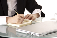 Close-up of businesswoman writing