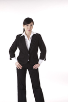 Businesswoman standing and looking at the camera with hands