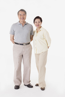 Senior man and woman standing and smiling together