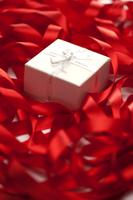 Gift box in tangled red ribbon 11010047903| 写真素材・ストックフォト・画像・イラスト素材|アマナイメージズ
