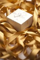 Gift box in tangled golden ribbon 11010047923| 写真素材・ストックフォト・画像・イラスト素材|アマナイメージズ