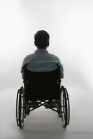 Senior man sitting on the wheel-chair with rear view