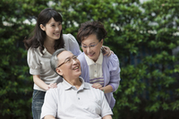 Young woman and senior couple smiling happily together