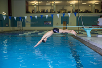 Young man jumping in the swimming pool