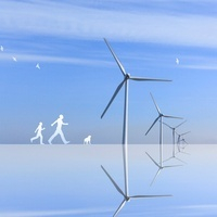 風力発電と歩く人