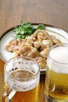 ホルモン焼き(コプチャン・ミノサンド)とビール