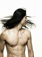 Man shaking his hair