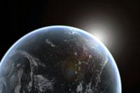 Sun emerging over planet earth 11015182249| 写真素材・ストックフォト・画像・イラスト素材|アマナイメージズ