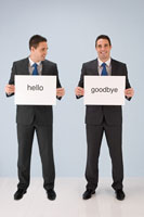 Businessmen holding signs 11015182656| 写真素材・ストックフォト・画像・イラスト素材|アマナイメージズ