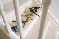 Toy dinosaurs on stairs