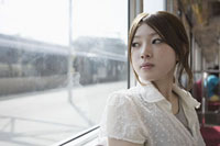 Young woman on train