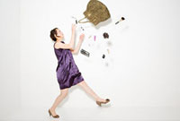 Woman and objects falling out of handbag