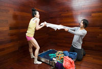 Couple fighting over clothes