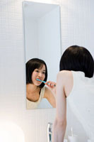 Japanese woman brushing her teeth