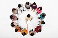 Handshake in circle of people