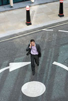 Businessman crossing the street