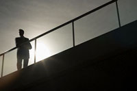 Silhouette of a businessman on a bridge
