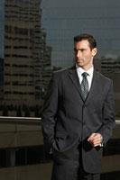 Portrait of a businessman against a city background