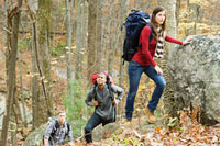 Young people on boulders in forest