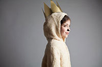 Young girl dressed up as sheep,wearing gold crown