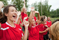 Female soccer players cheering