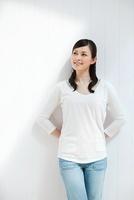 Woman wearing white top, portrait