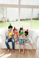 Family with two children with balloons