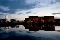 Sunset over waterfront towards Albert Dock, Liverpool, UK